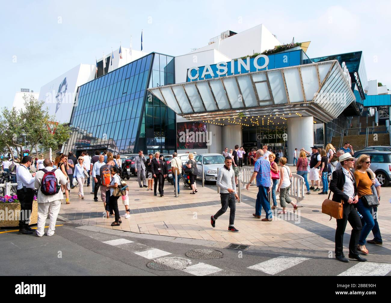 CANNES, FRANCE - MAY 14: People around the Casino and the Palais des Festivals, in the Promenade de la Croisette, during the 68 edition of the Cannes Stock Photo