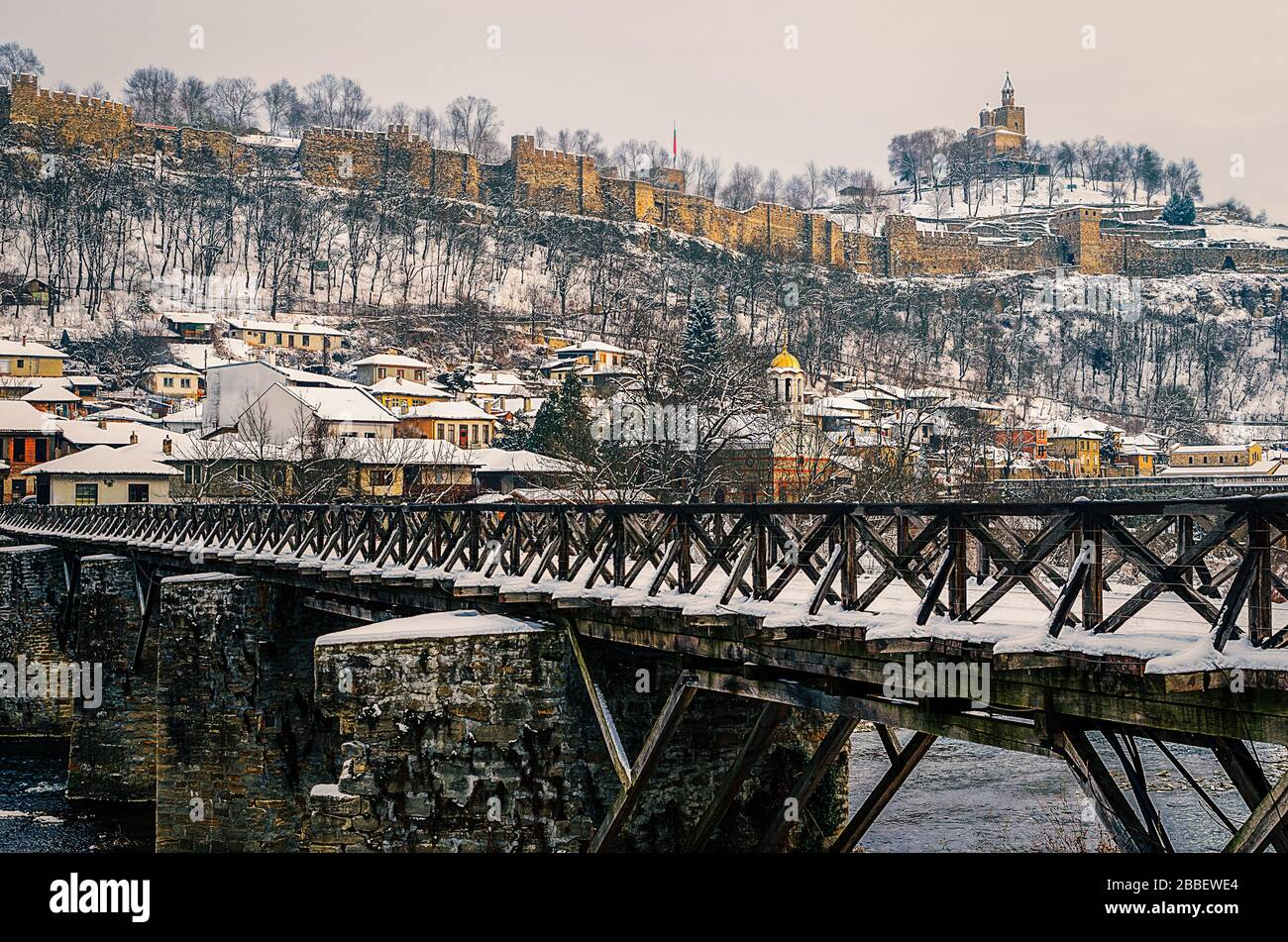 View of Tsarevets fortress and bishops bridge over River Yantra in winter Veliko Tarnovo Bulgaria Stock Photo