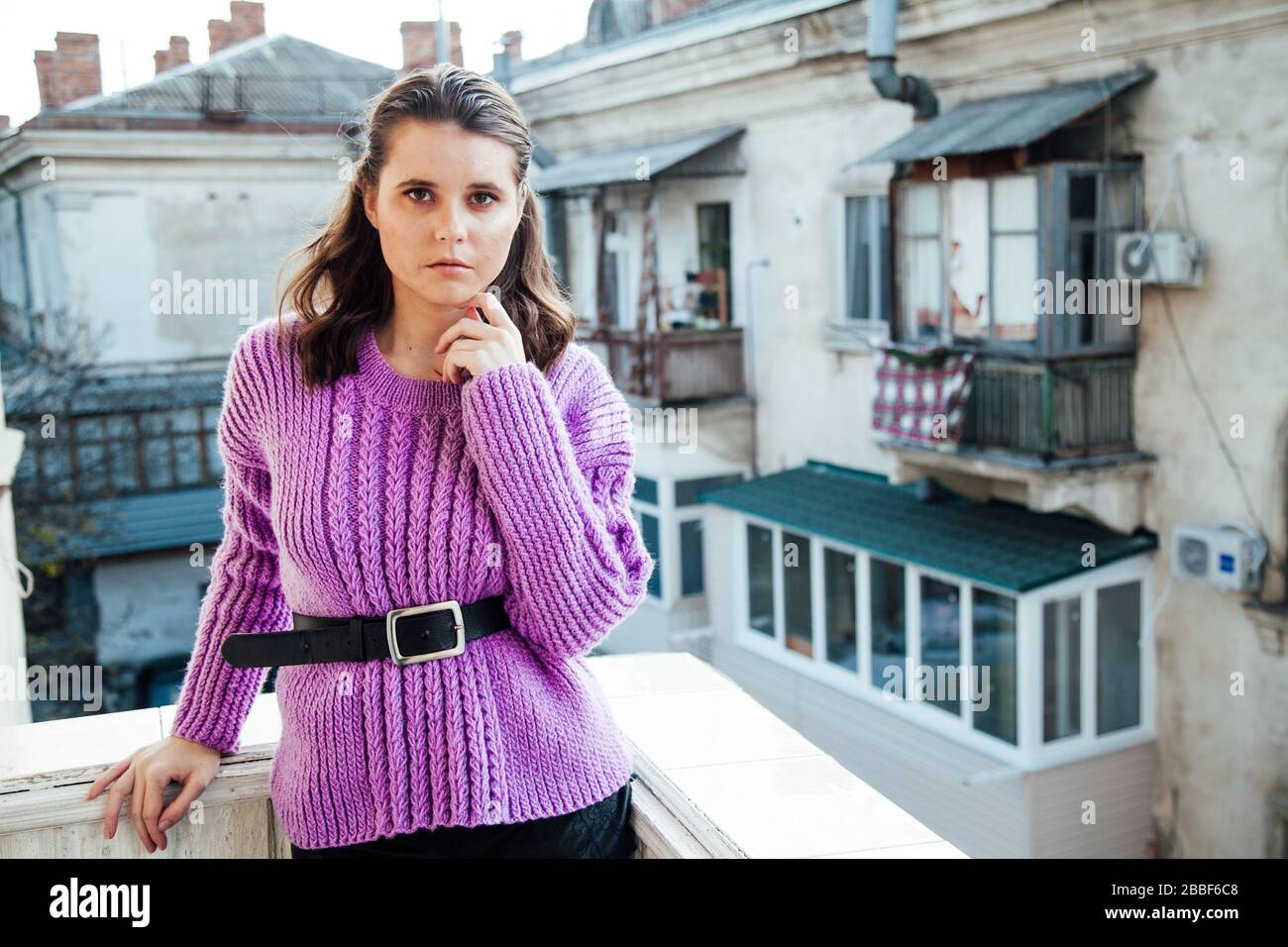 portrait of a beautiful fashionable woman in a purple sweater Stock Photo