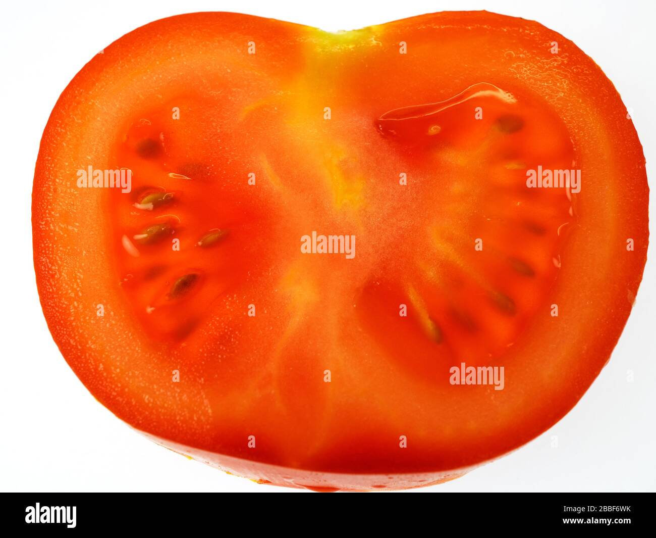 A single ripe red tomato slice on a white background Stock Photo