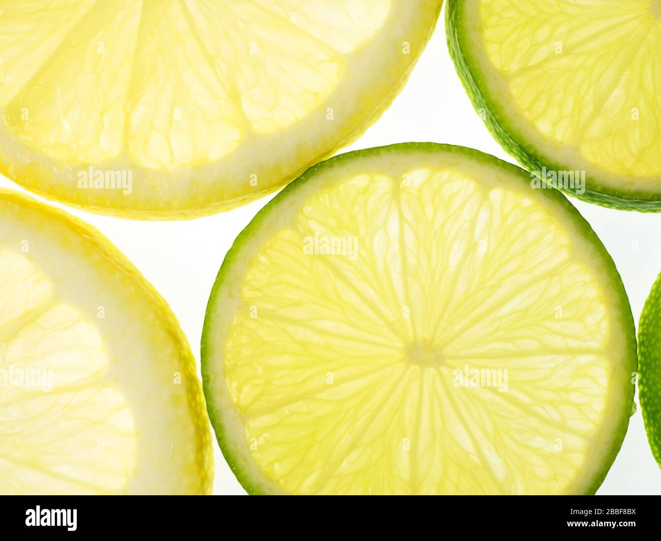Slices of lemon and lime on a white background Stock Photo