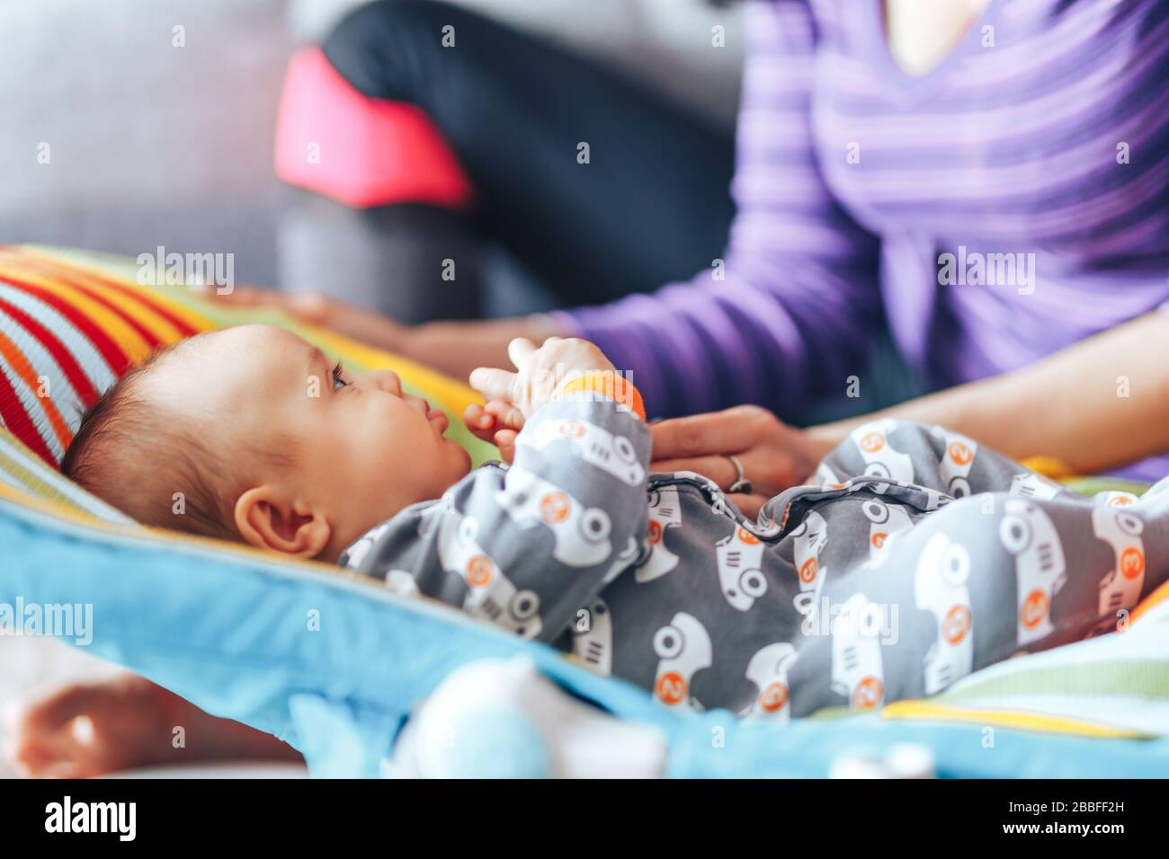 beautiful mother with newborn cute baby at home Stock Photo