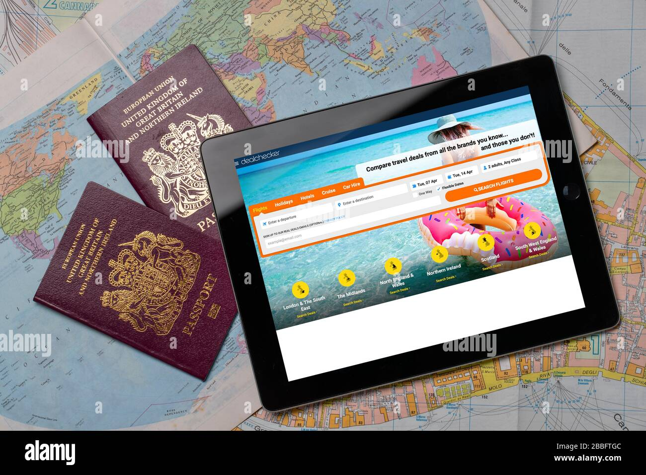 Deal Checker Travel  website on an iPad or tablet. (editorial use only) Stock Photo