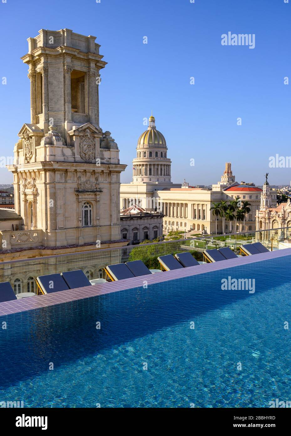 Rooftop view with  infinity pool of El Capitolio, or the National Capitol Building, and Museo Nacional de Bellas Artes, from roof of Gran Hotel Manzana Kempinski, Havana, Cuba Stock Photo