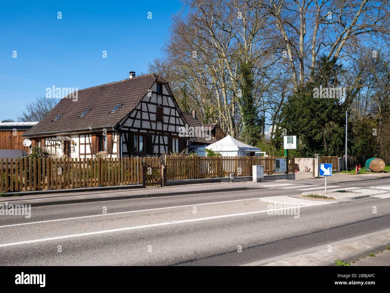 Strasbourg, France - Mar 18, 2020: Jardin de Marthe bio farmer store facade with empty street due to coronavirus outbreak Stock Photo