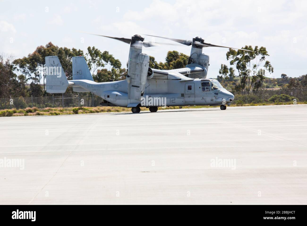 A U.S. Marine Corps MV-22B Osprey assigned to Marine Medium Tiltrotor Squadron 163, Marine Aircraft Group 16, 3rd Marine Aircraft Wing, takes off at Marine Corps Air Station Miramar, Calif., March 26, 2020. 3rd MAW continues its daily operations and mission essential tasks while enforcing precautionary measures to mitigate the spread of COVID-19. (U.S. Marine Corps photo by Lance Cpl. Julian Elliott-Drouin) Stock Photo