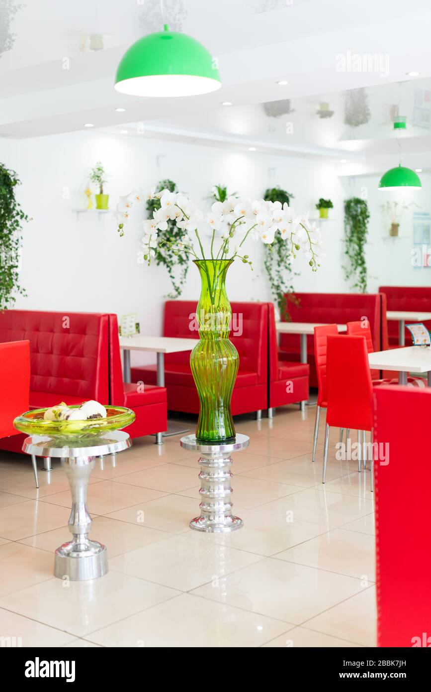 Modern Design Restaurant Interior In White And Red Colors With Plants Stock Photo Alamy