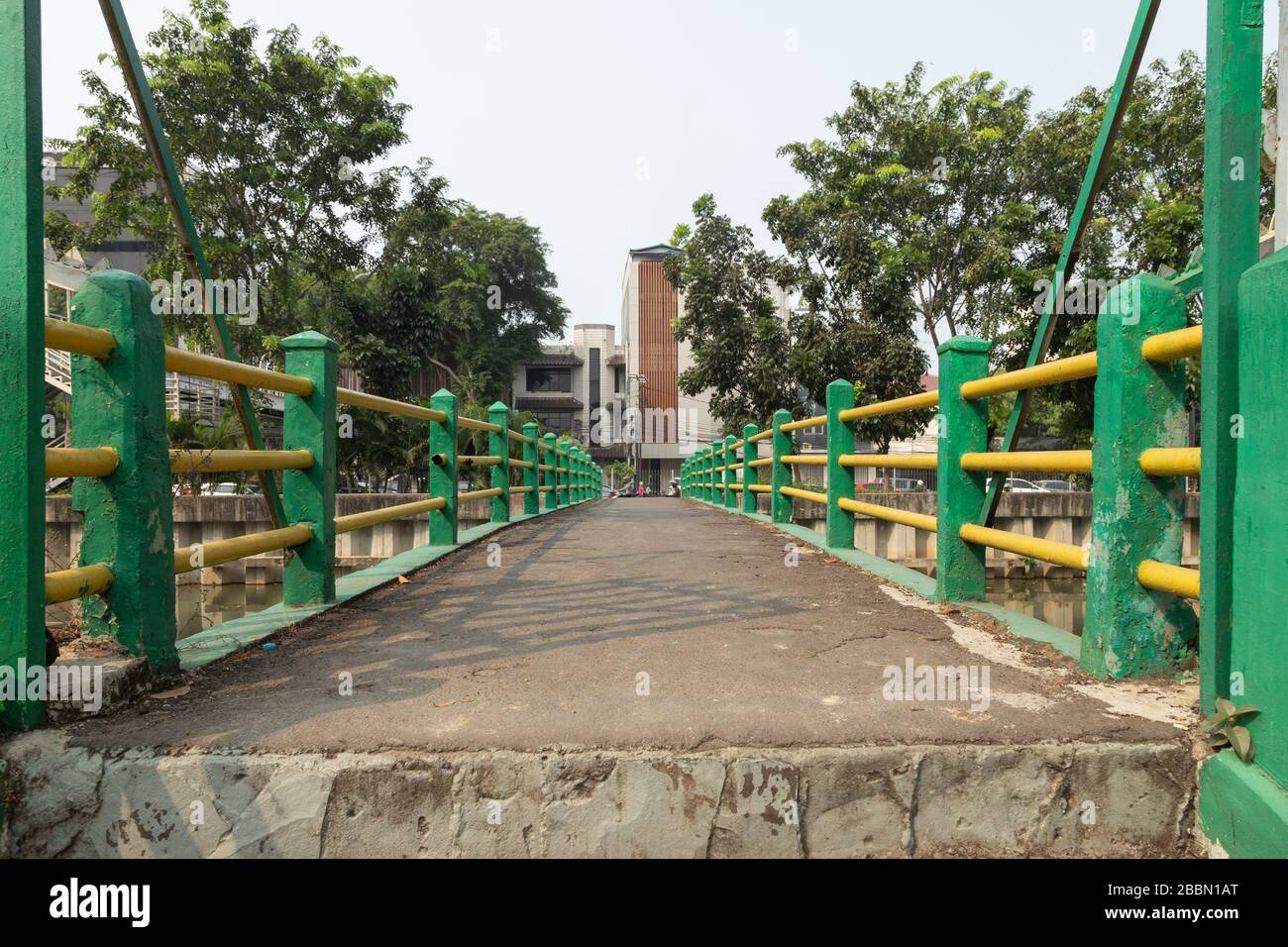 Jakarta, Indonesia - July 13, 2019: Footbridge exclusively for pedestrians, with a green painted railing, allows passage in Kartini Raya street. Stock Photo