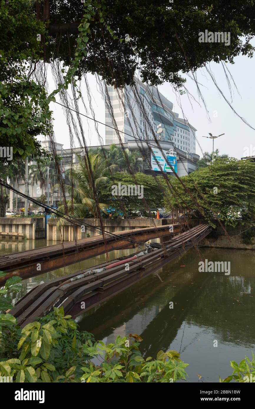 Jakarta, Indonesia - July 13, 2019: Access gate one of the multiple bridges for the passage of pipes and electrical cables in Jakarta. Stock Photo