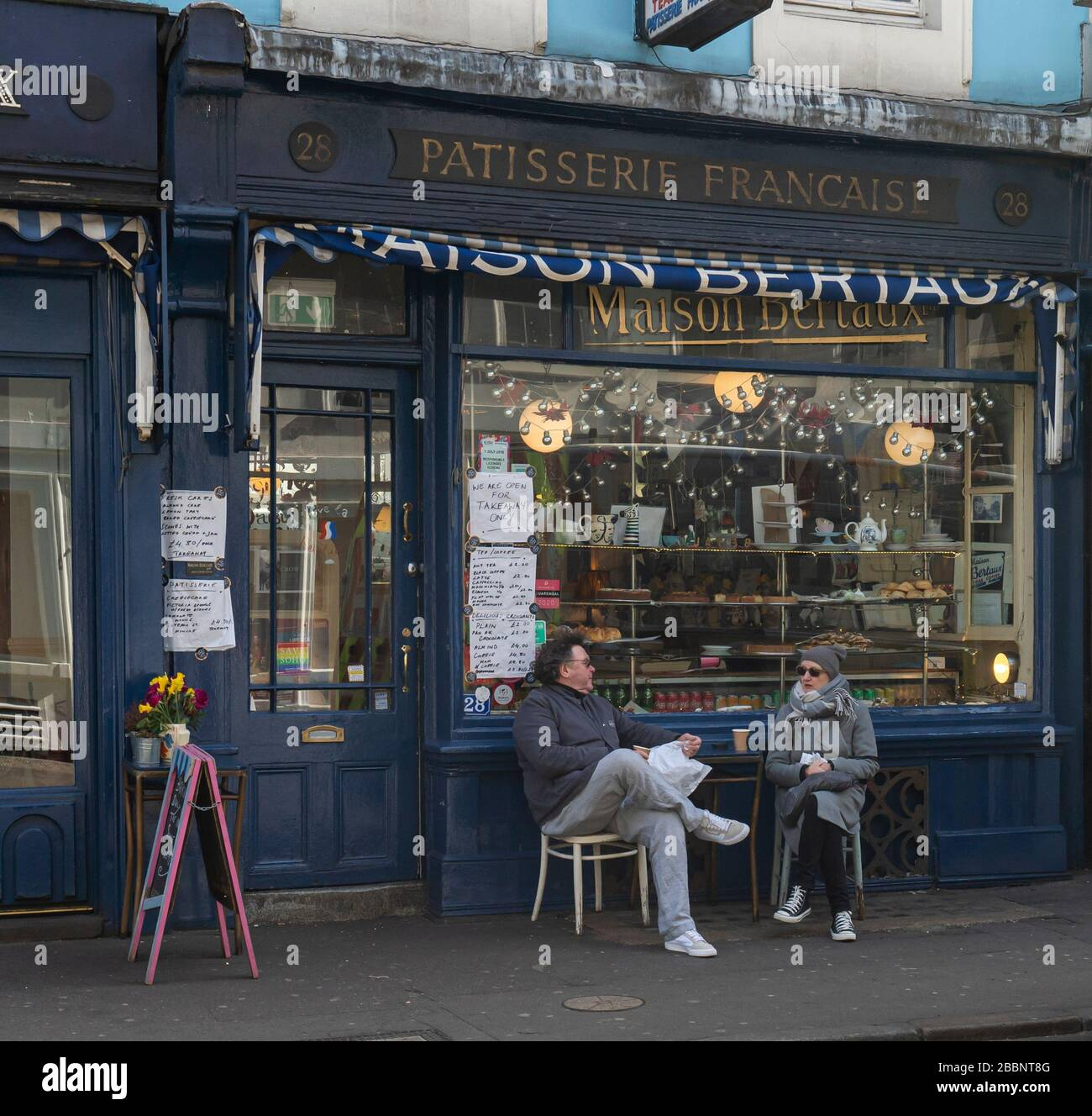 © 2020 Andrew Baker 21st March 2020. A couple defy the UK Governments advice to stay at home to prevent the spread of the Corona Virus in Soho, London. Stock Photo