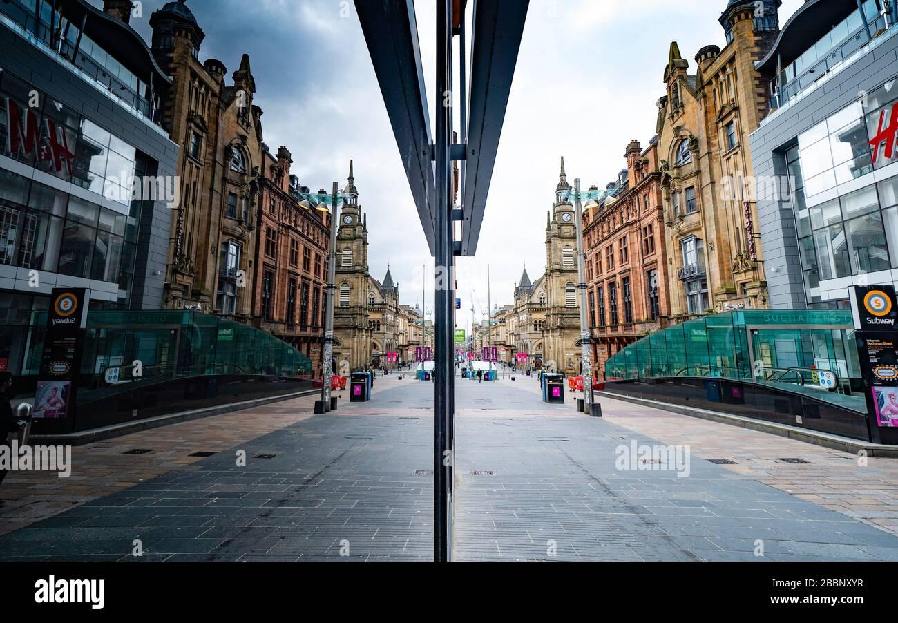 Glasgow, Scotland, UK. 1 April, 2020. Effects of Coronavirus lockdown on streets of Glasgow, Scotland. A deserted Buchanan Street reflected in a shop window. Iain Masterton/Alamy Live News Stock Photo