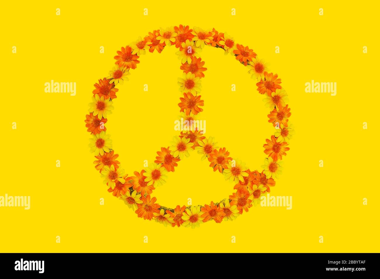 Flower Power Peace Sign Made Out Of Flowers On A Yellow Background Stock Photo Alamy