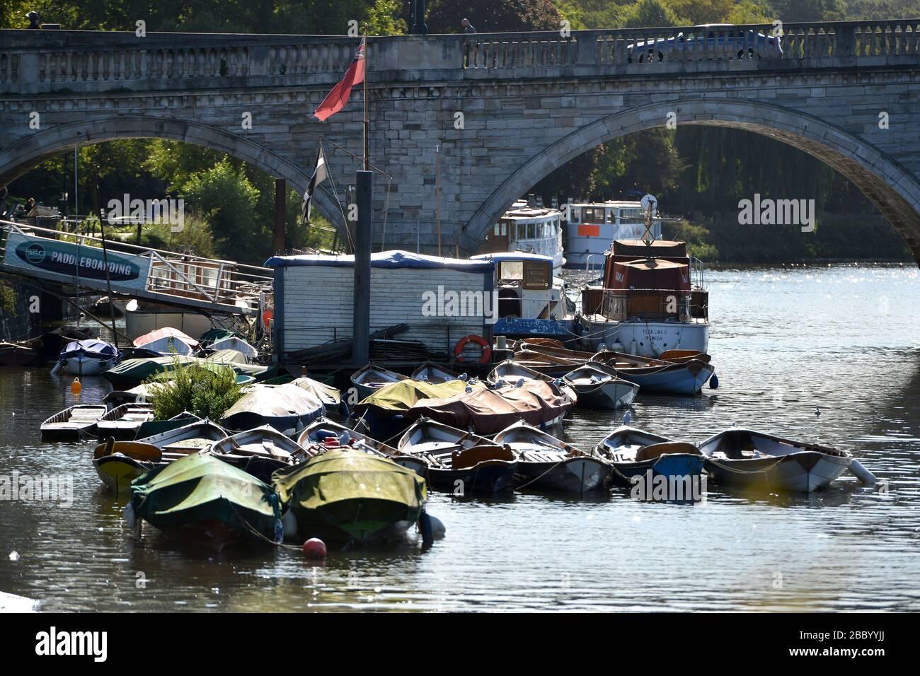 Boats on the Thames by Richmond Bridge, Richmond, London, UK Stock Photo