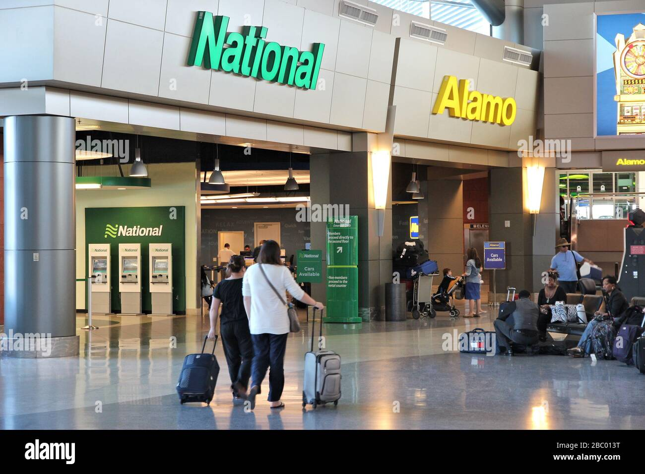 LAS VEGAS, USA - APRIL 13, 2014: Alamo and National car rental airport office in Las Vegas. Both brands are owned by Enterprise Holdings, company empl Stock Photo