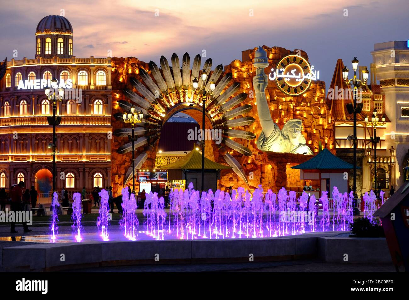 Night time shot of the Americas section inside Global Village, Dubai, UAE. Global Village combines cultures of 90 countries across the world. Stock Photo