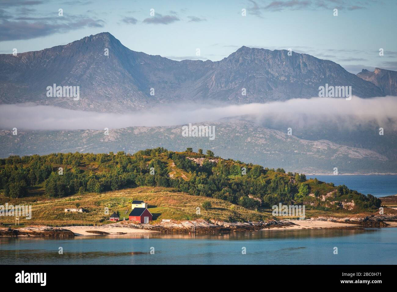ISOLATED HOUSES ON AN ISLAND IN THE MIDDLE OF THE FJORD, SOMMAROY, ISLAND OF KVALOYA, TROMSO, NORWAY Stock Photo