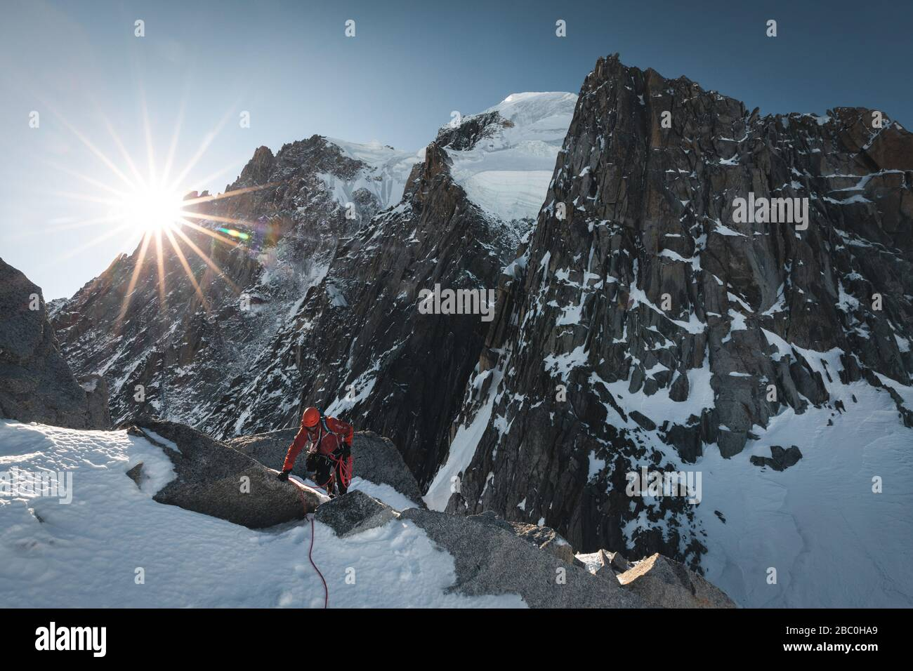 GUIDE ON THE RIDGE OF THE POINTES LACHENAL AT THE FOOT OF THE SERACS DU MONT BLANC DU TACUL, ONT-BLANC MOUNTAIN RANGE, CHAMONIX-MONT-BLANC, HAUTE-SAVOIE (74), FRANCE Stock Photo