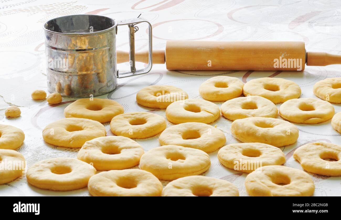 Donut dough is laid out on a table in the kitchen Stock Photo