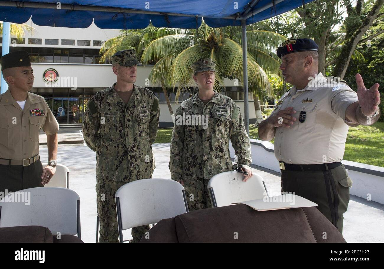 Guatemalan Naval Infantry Force Coronel Jose Ricardo Sosa Mirón, right, speaks to, from left, U.S. Marine Corps Maj. Romeo Cubas, the Southern Partnership Station (SPS) 2014 detachment officer in charge; U.S. Nav 140808 Stock Photo
