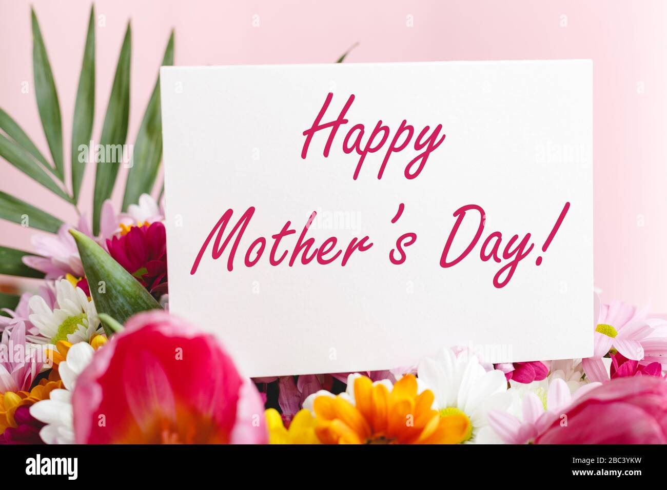 Happy Mothers Day Text On Gift Card In Flower Bouquet On Pink Background Greeting Card For Mom Flower Delivery Congratulations Card In Flowers For Stock Photo Alamy