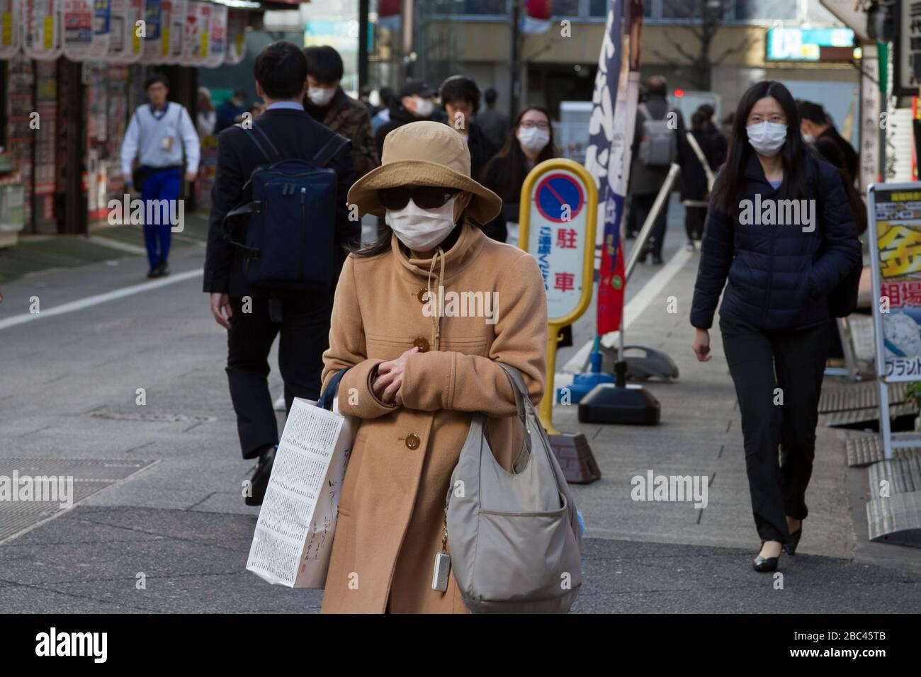 People wearing surgical masks to avoid diseases like the COVID-19 Corona Virus  in Shinjuku, Tokyo, Japan, Thursday February 27th 2020 Stock Photo