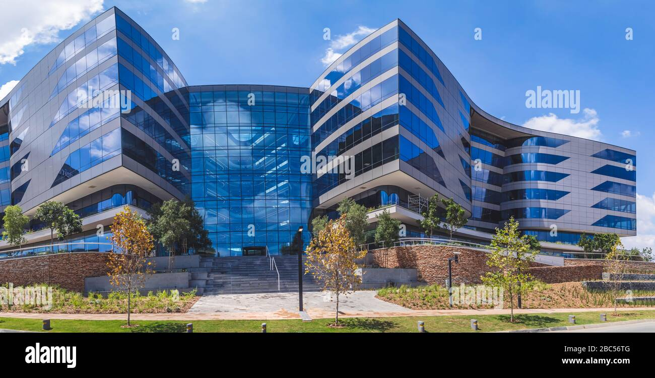 Johannesburg, South Africa,14th March - 2020: Exterior of modern office building with glass facade. Stock Photo