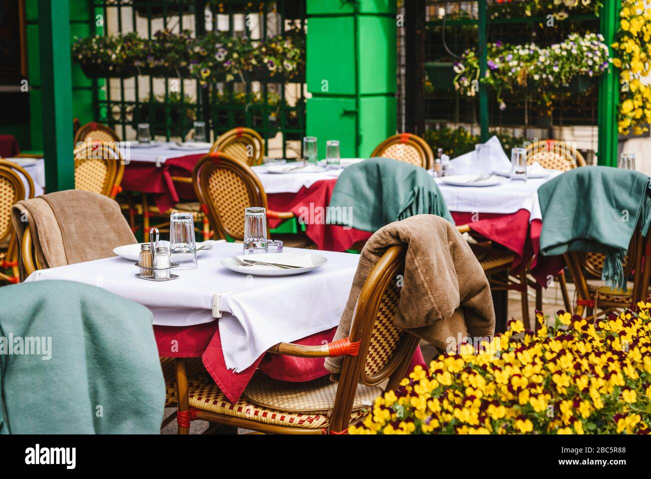 Beautiful Retro Styled Cafe Restaurant Exterior Outdoor Chairs And Tables And Fresh Flowers Stock Photo Alamy
