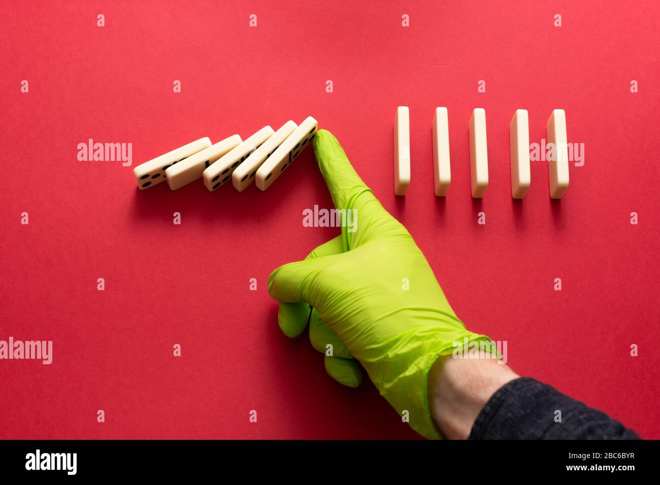 Physical distancing. Avoiding close contact is the key to slowing coronavirus Covid-19. Social distancing concept. Domino effect. Stock Photo