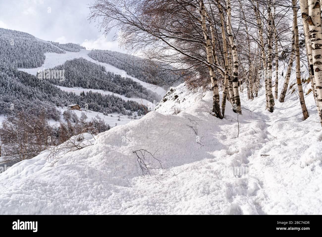 Aerial view the Pyrenees Mountains in Andorra , Grandvalira ski area in El Tarter one winter day . Stock Photo
