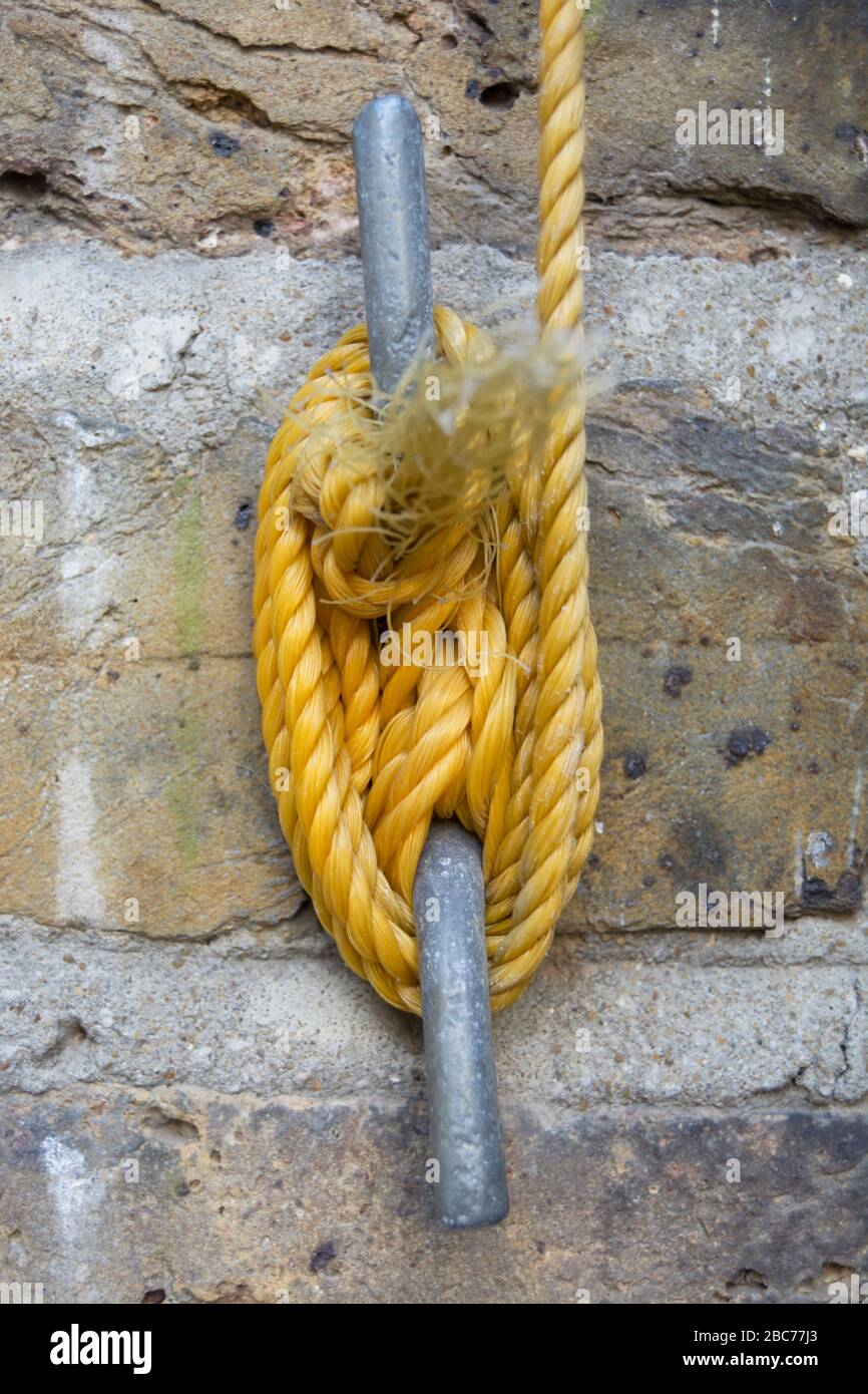 Nylon Washing Line Rope Wrapped Around A Cleat Hook Fixed To A Brick Wall Stock Photo Alamy