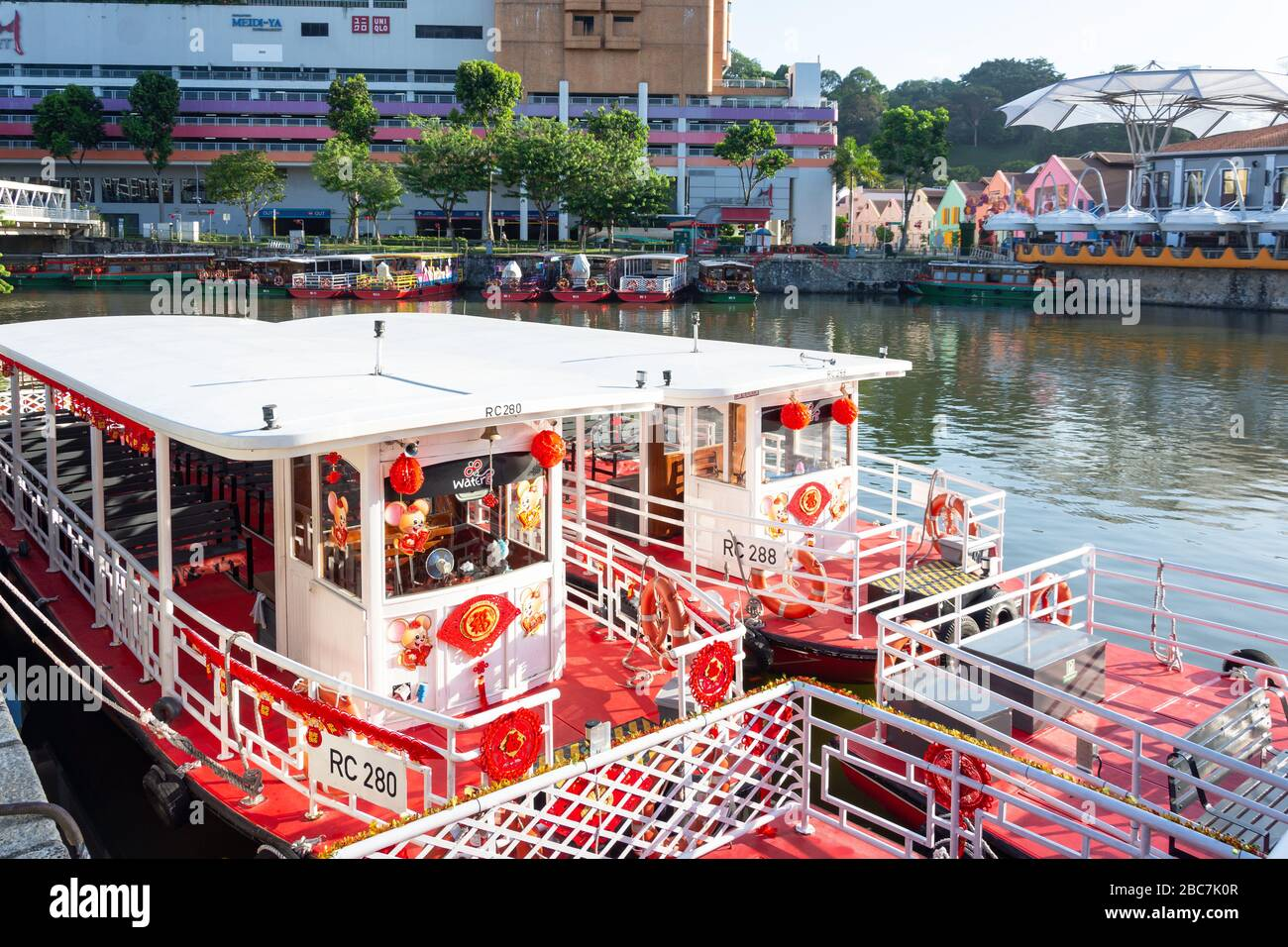 River cruise boats moored on Singapore River, Clarke Quay, Central Area, Singapore Stock Photo