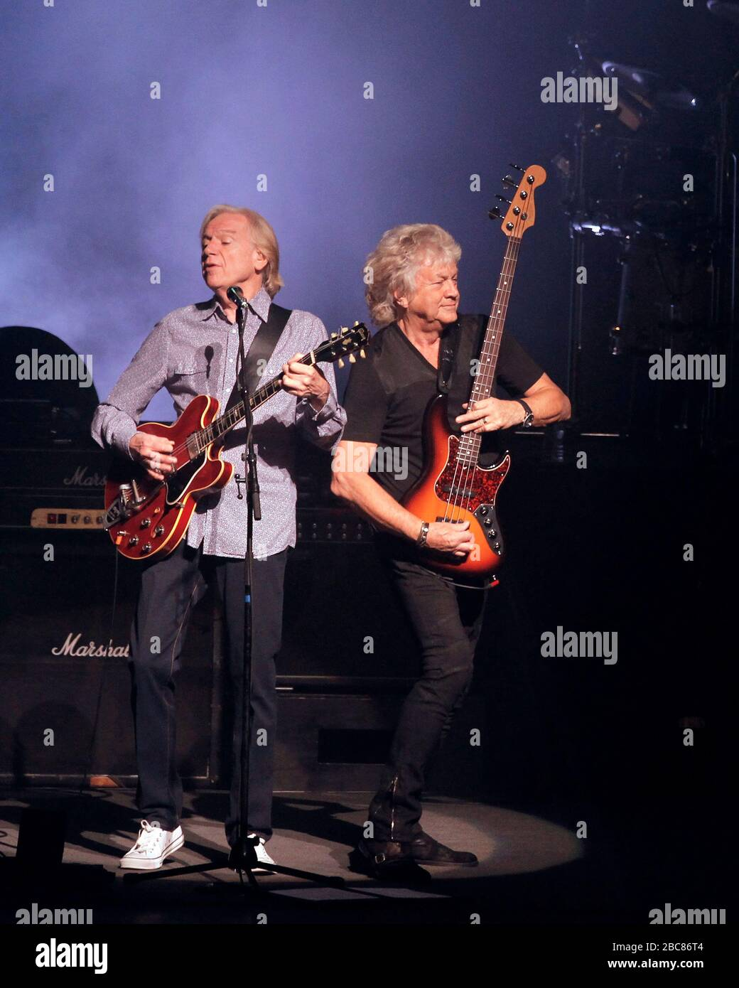 Justin Hayward And John Lodge L To R Of The Moody Blues Perform With Graeme Edge