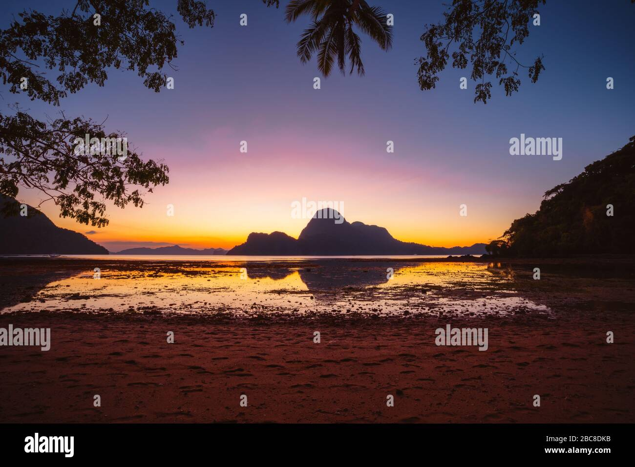 Sunset On A Tropical Island With Silhouette Of Palm Trees El Nido Bay Philippines Stock Photo Alamy