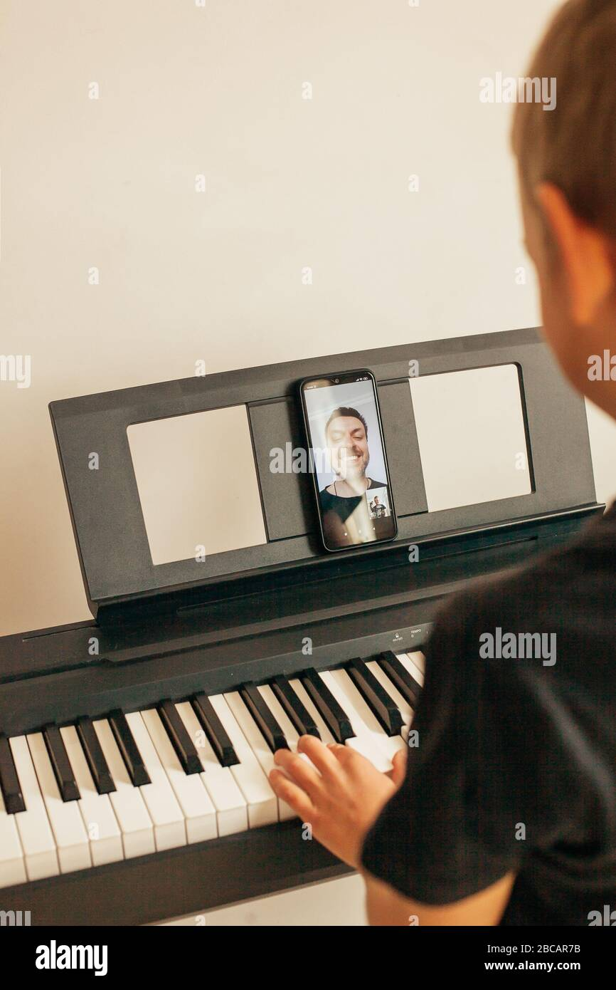 Child hands playing piano.Cllose-up piano, white and black keyboard Stock Photo