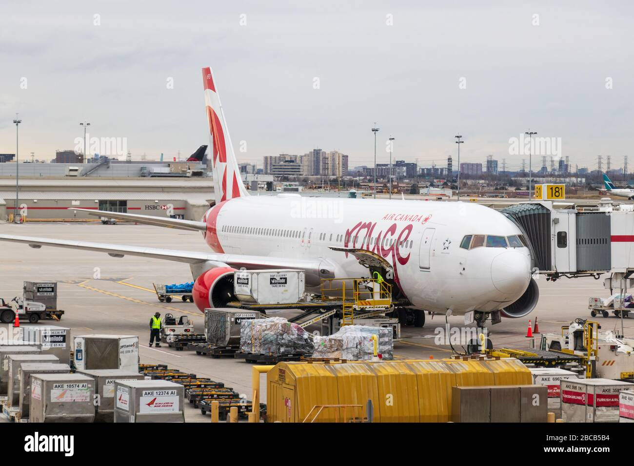 Air Canada Rouge Boeing 767 aircraft is seen at gate being loaded with cargo at Toronto Pearson Intl. Airport. Stock Photo