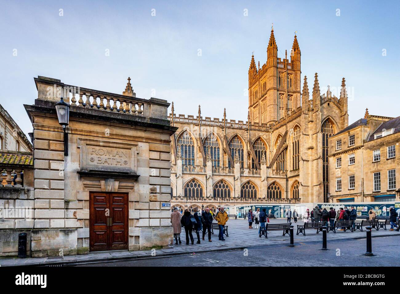 Old entrance to the Roman Baths with Bath Abbey, Bath, Somerset, England, UK Stock Photo