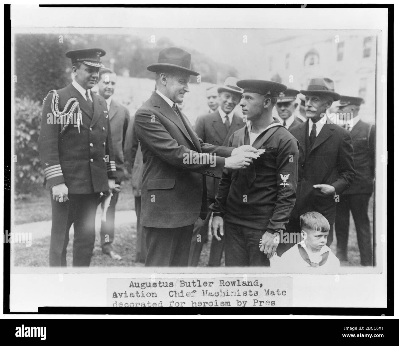 """""""English: Title: Augustus Butler Rowland, Aviation Chief Machinists Mate, decorated for heroism by Pres. Coolidge Abstract/medium: 1 photographic print.; 1925; Library of Congress  Catalog: http://lccn.loc.gov/2002712396 Image download: http://cdn.loc.gov/service/pnp/cph/3c30000/3c31000/3c31500/3c31578v.jpg Original url: https://www.loc.gov/pictures/item/2002712396/; National Photo Company Collection; """" Stock Photo"""