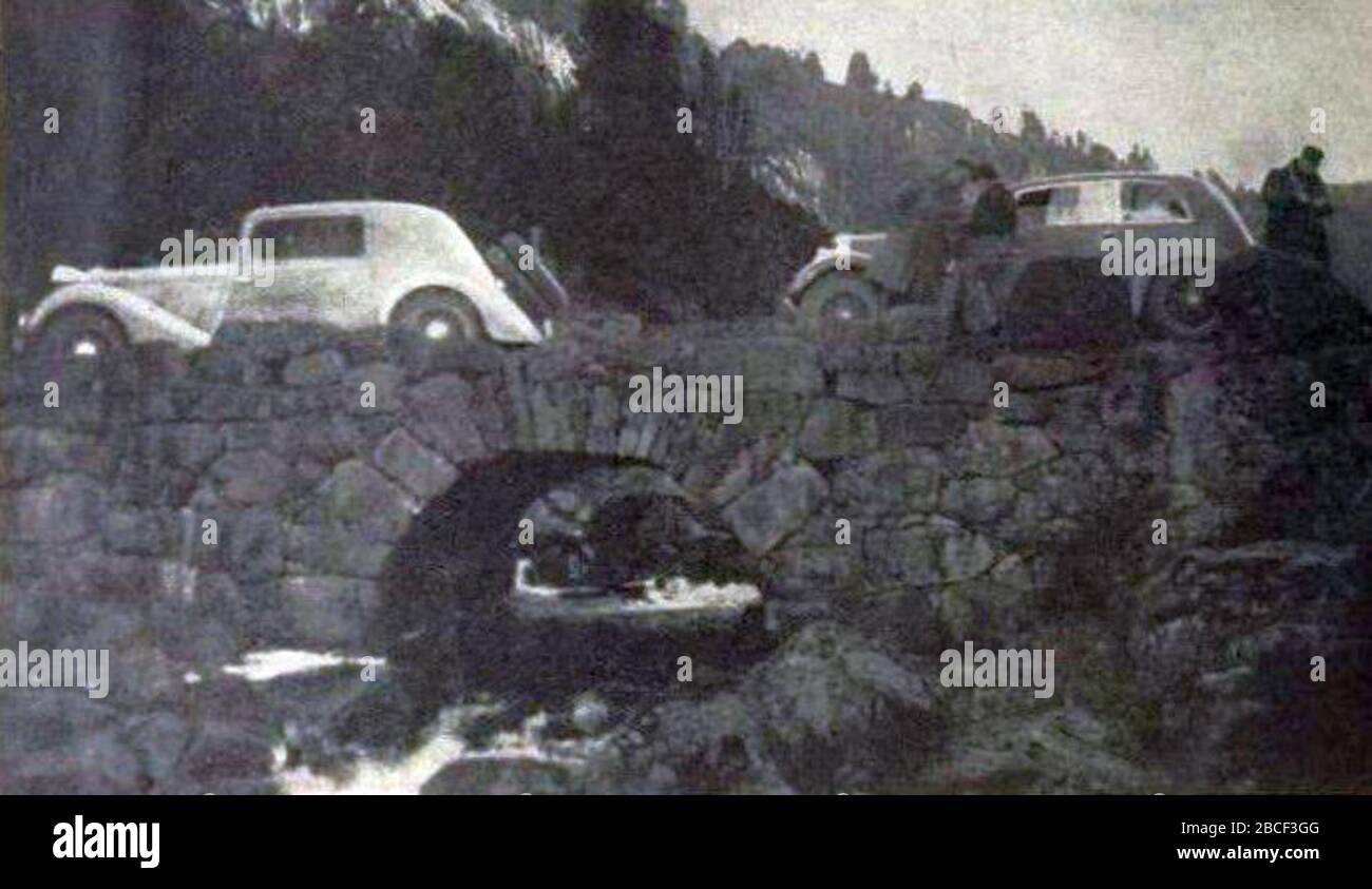 """""""Français: Rallye Monte Carlo 1934, Charles Lahaye et Raymond Quatresous sur Renault au départ de Stavanger. English: Entry #57 in the 1934 Rallye Monte Carlo was a Renault, driven by Charles Lahaye and René Quatresous. The french uploader suggests Raymond Q., but this is most likely the René Q. that Lahaye entered with in 1935 as well. The Renault is possibly the Nervastar CS they used in 1935, which when compared to the 1935 pictures, then would be the first car on the bridge (the one to the left in the picture). They had started in Stavanger.[1]; 5 November 2017; L'Automobile sur la Côte d Stock Photo"""