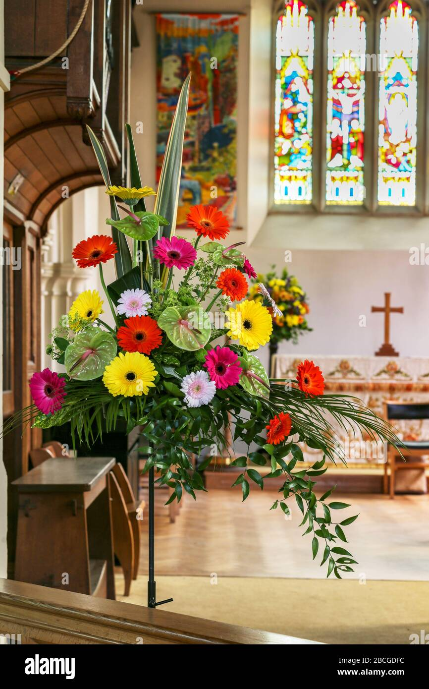 A Vivid Colourful Wedding Flower Arrangement Near The Alter In An English Church Of England Church Stock Photo Alamy