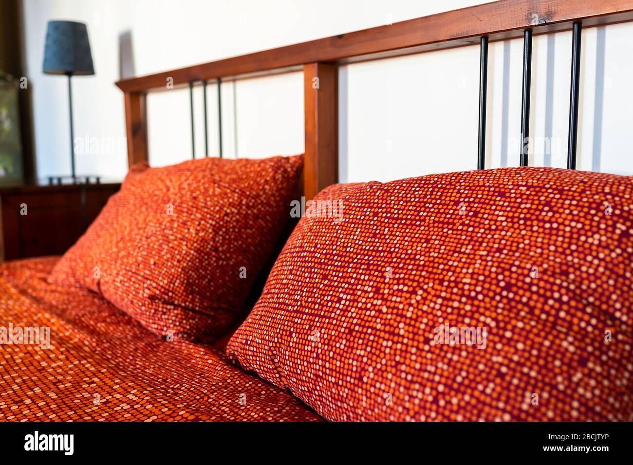 Antique Vintage Retro Bedroom With Red Orange Pattern Bed Pillow In Room With Wooden Headboard In Home In Europe Stock Photo Alamy