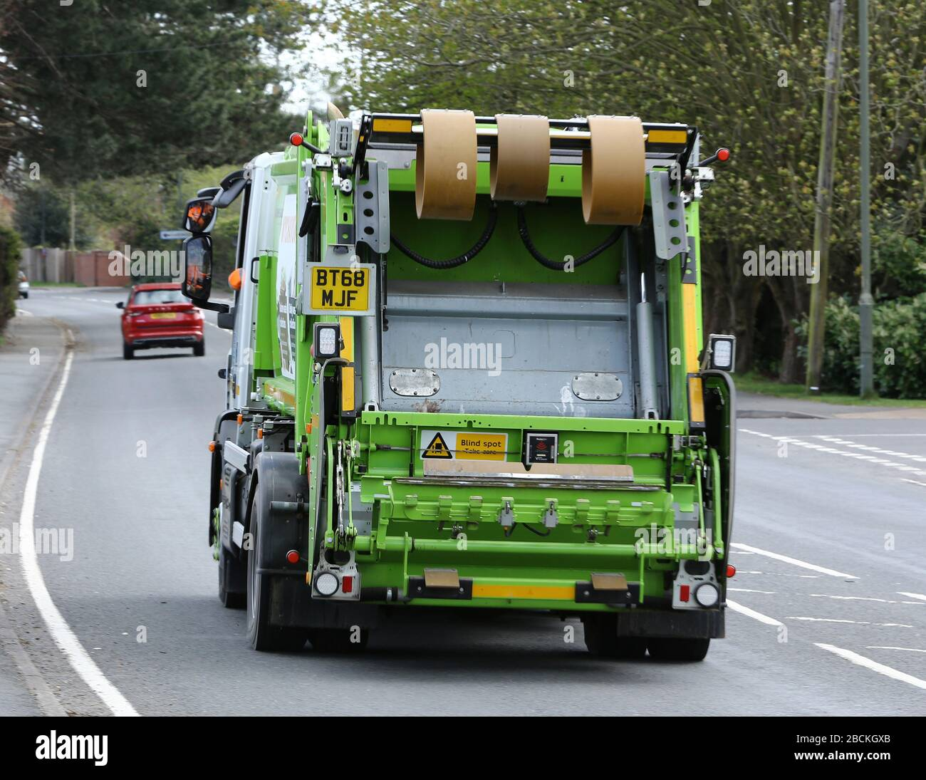 Council Rubbish Collectors providing an Essential Service during the Pandemic Lockdown. Stock Photo