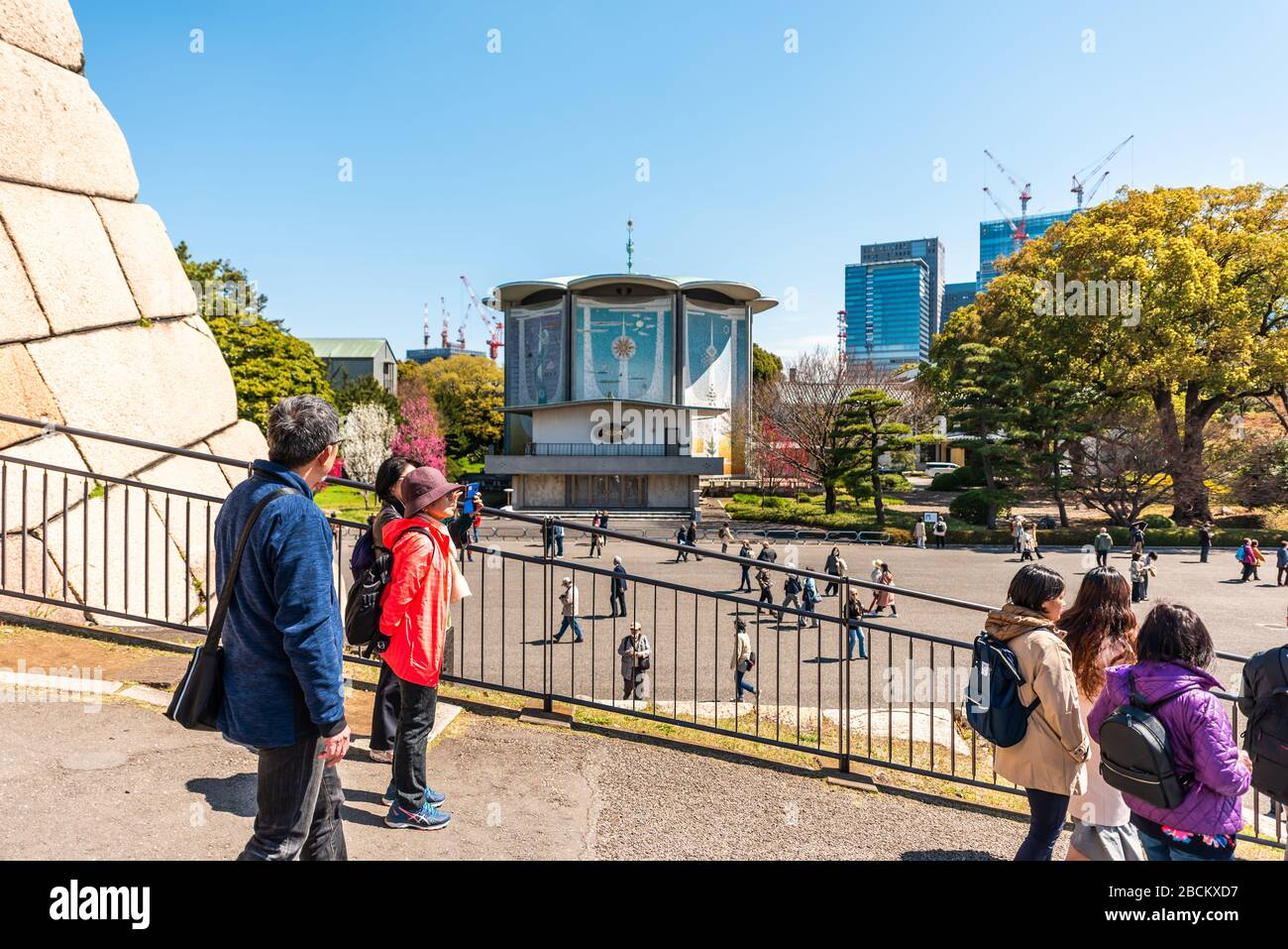 Tokyo, Japan - April 1, 2019: Imperial palace national gardens park with people at Edo period castle keep and Tokagakudo Imperial household agency dep Stock Photo