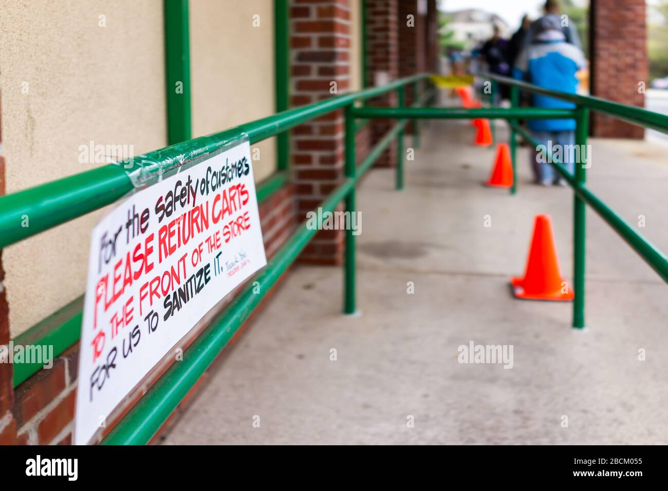 Reston, USA - April 1, 2020: Trader Joe's grocery store sign for customers to return shopping carts to store front to clean, for cleaning and sanitizi Stock Photo