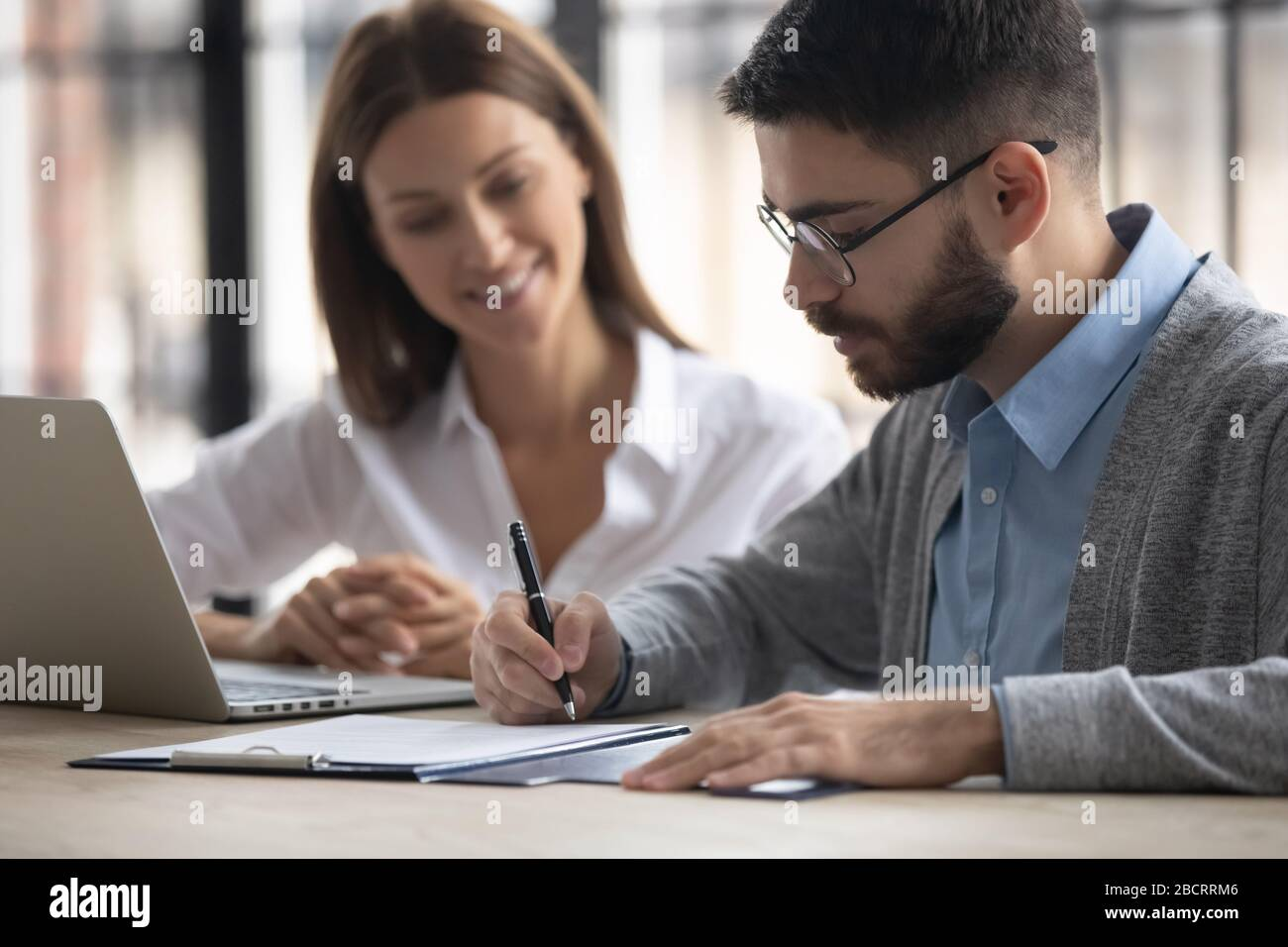 Close up handsome businessman signing partnership agreement concept. Stock Photo