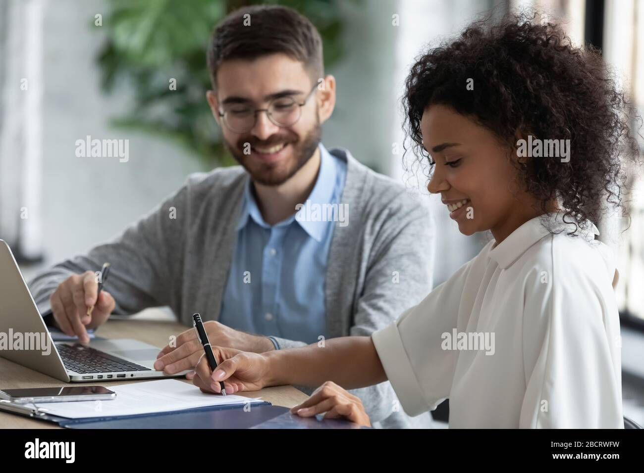 Close up african american businesswoman signing partnership agreement concept. Stock Photo