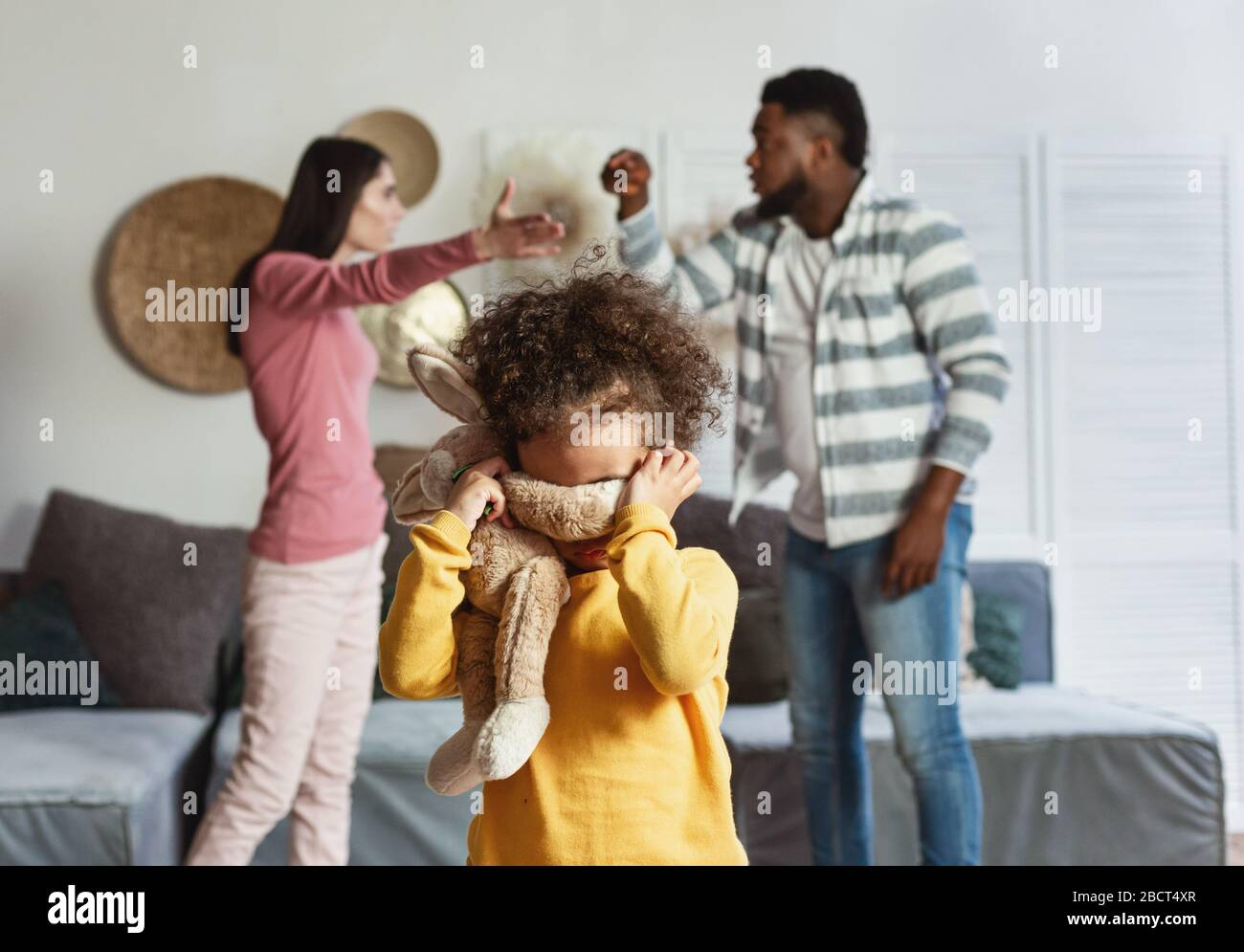 Baby cries when international parents are quarrel Stock Photo