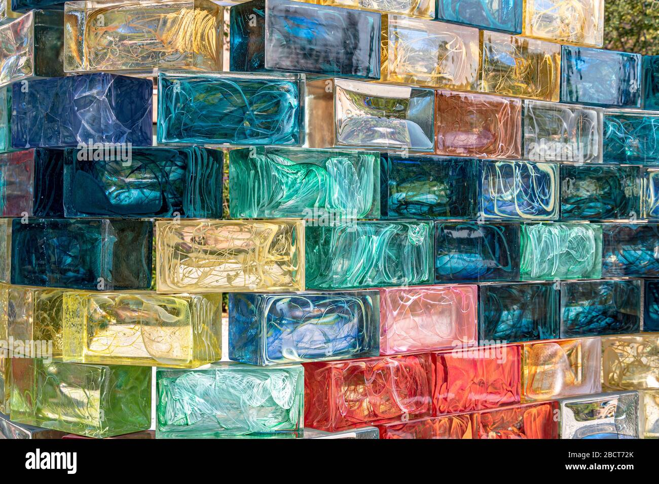 A curved wall of coloured glass blocks created by Pae White named Qwalala on the island of San Giorgio Maggiore ,Venice ,Italy Stock Photo