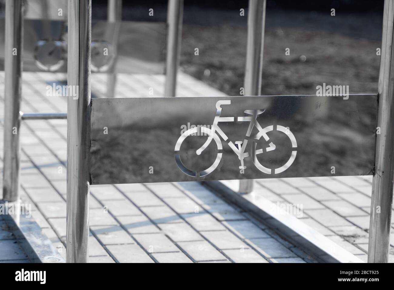 Empty bicycle parking with a sign of bicycle on a street. Stock Photo