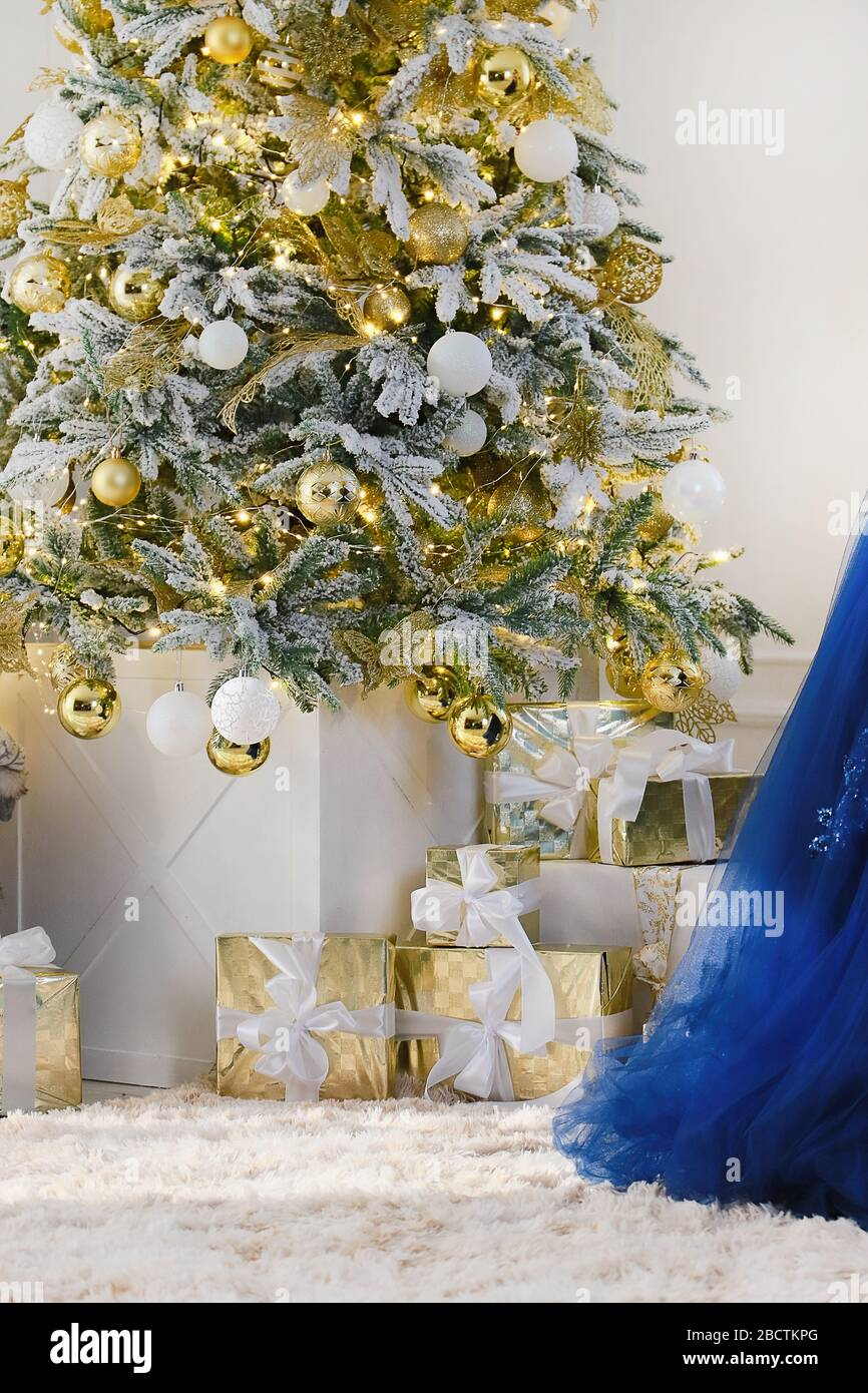 Christmas Gifts Under A Decorated Christmas Tree With White Wall Background New Year Holiday Background Stock Photo Alamy