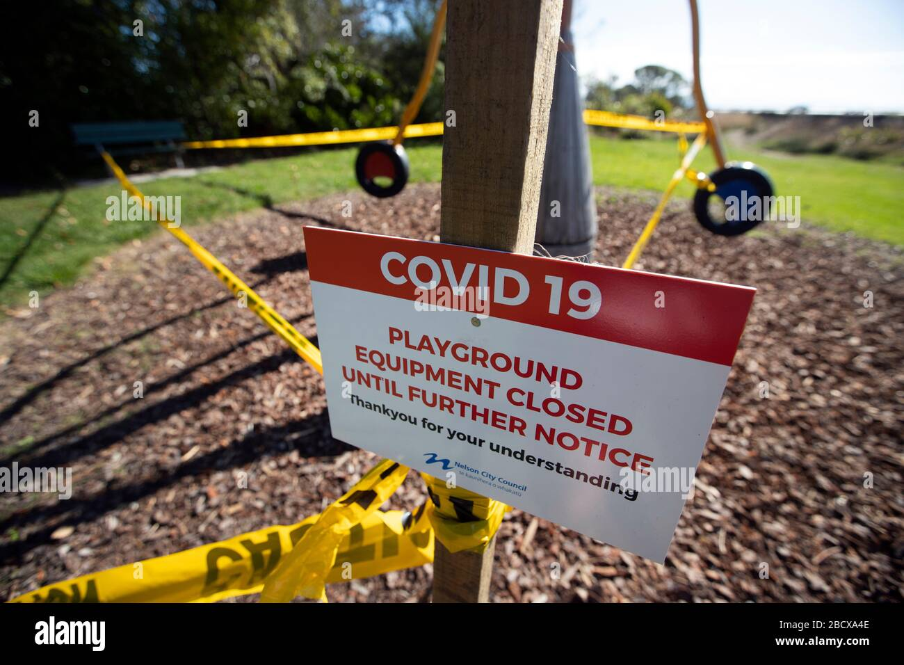 Signs at closed playground due to Covid 19 virus lockdown, Nelson, New Zealand Stock Photo